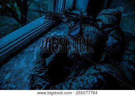 Army sniper team shooting with large caliber rifle poster