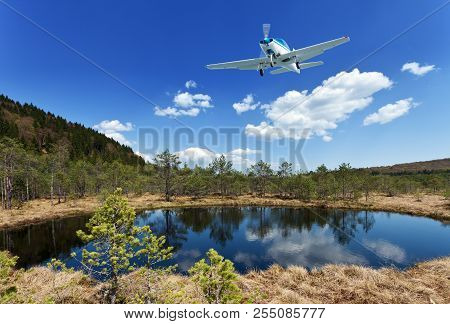 Exploring The Wilderness - Small Aircraft Flying Above Scenic View Of Small Lake And Forest