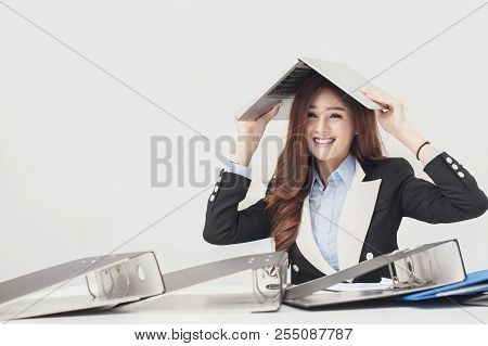 Business Woman Has A Sense Of Humor. By Putting The Laptop On The Head And Smiling. The Concept Of R