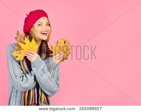 Autumn Time. Woman Holds Yellow Leaf. Woman With Autumn Yellow Maple Leaves. Autumn Fashion. Smiling