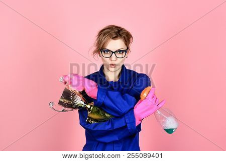 Cleaning, cleanliness, cleaning products, housework, housekeeping. Woman in uniform and gloves holds cleanser spray and gold trophy cup. Woman from professional cleaning service. Duties, domestic work poster