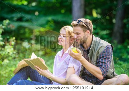 Romantic Date At Green Meadow. Couple In Love Spend Leisure Reading Book. Couple Soulmates At Romant