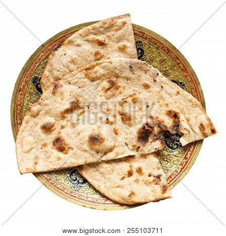 Indian Cuisine - Tandoori Roti Whole Wheat Flat Bread On Brass Plate Isolated On White Background