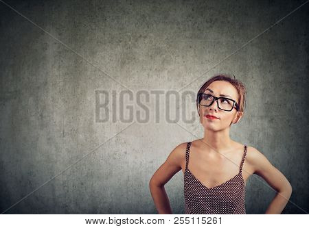 Closeup Of A Woman Wondering Thinking Contemplating On Idea
