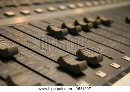 Sliders On An Audio Mixer Board