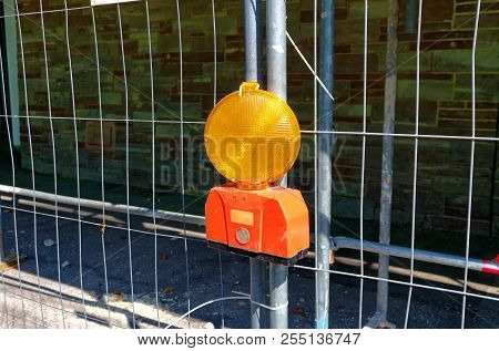 Construction Site Lamp At A Construction Site With Scaffolding And Construction Site Barrier In The