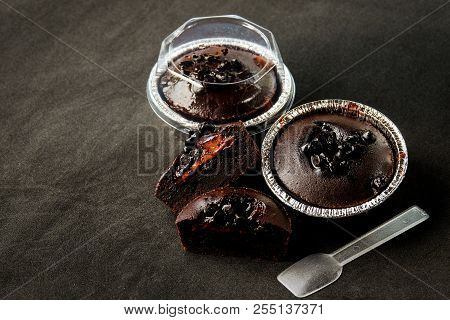 Muffin Dark Chocolate Lava With Chocolate Chip In Foil Tray Bread With Plastic Spoon For Dessert Bac