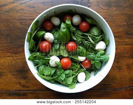 Delicious Baby Spinach Salad With Mozzarrella Balls And Mini Tomatoes