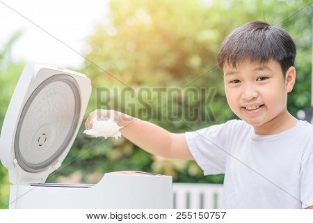 Asian Boy And Rice Cooker