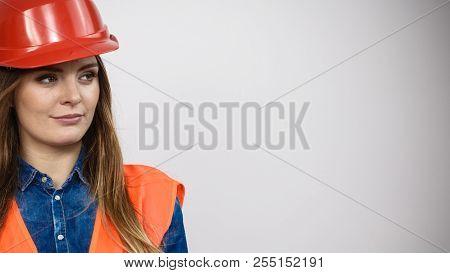 Woman Construction Worker Builder Structural Engineerin In Orange Vest Red Hard Helmet. Safety In In