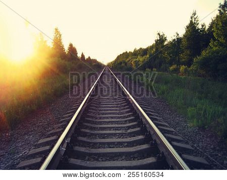 Rail Road At Sunset Summer Beautiful Landscape With Empty Sky. Train Rail Track Perspective View Wit
