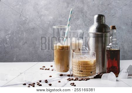 Iced Coffee Cocktail Or Frappe With Ice Cubes And Cream In Different Glasses With Silver Shaker, Bot