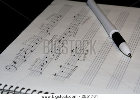 handwritten notes in music book on black background poster