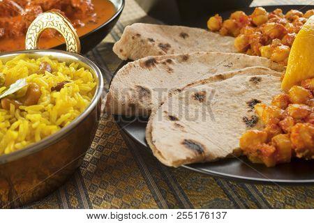Chapatis With Channa Dhal, Pillau Rice And Rogan Josh.