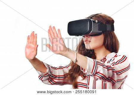 Young Woman Using A Virtual Reality Headset And Smiling Isolated On White Background. Studio Image