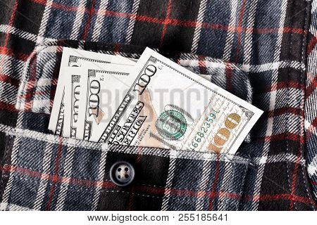 American Dollars, Hundred-dollar Notes, Sticking Out Of The Shirt Pocket. Pocket In Shirt With Hundr