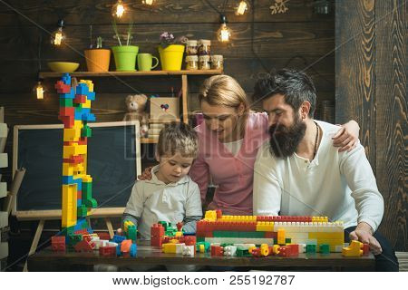 Education Concept. Child Play Game With Mother And Father, Education. Family Day Care Education And