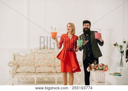 Valentines Day Concept. Happy Woman And Man Smile With Potted Flowers On Valentines Day. Sensual Wom