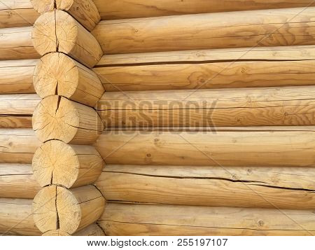 Corner Of Blockhouse Closup. Brown Rustic Wooden Texture Background. Facade Of A Log House, Copy Spa