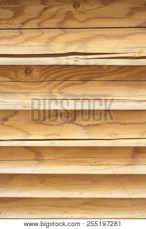 Textured Horizontal Wooden Wall From Logs. Wooden Texture Background Wall Of Blockhouse