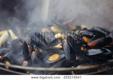 Ready Mussels In A Cast Iron Pan With Smoke And Steam