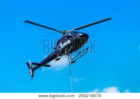 Lavaux, Switzerland - August 30, 2016: Helicopter Flying In The Sky In Lavaux, Lavaux-oron District,