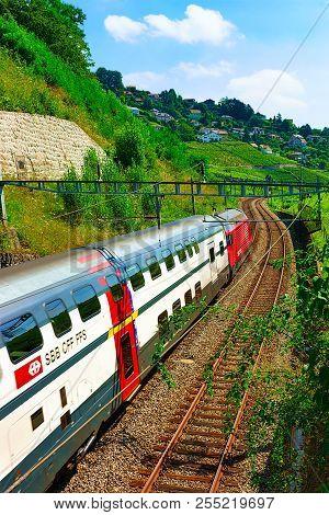 Lavaux, Switzerland - August 30, 2016: Swiss Running Train At Vineyard Terraces Hiking Trail Of Lava