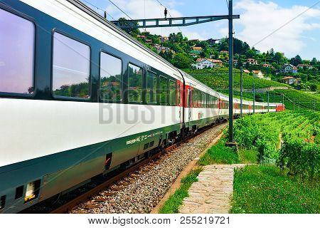Lavaux, Switzerland - August 30, 2016: Running Train And The Railroad On Lavaux Vineyard Terraces Hi