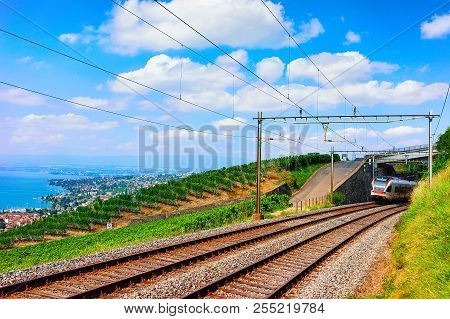 Lavaux, Switzerland - August 30, 2016: Running Train In Lavaux Vineyard Terraces Hiking Trail Near L