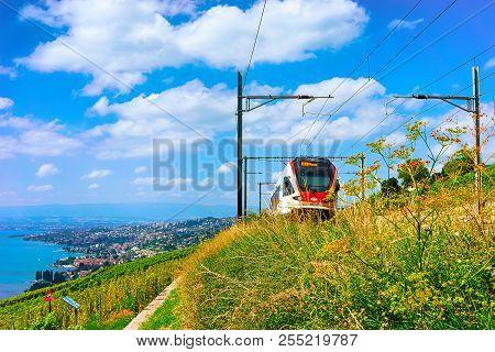 Lavaux, Switzerland - August 30, 2016: Running Train In Lavaux Vineyard Terraces Hiking Trail At Lak