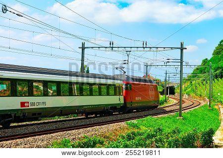 Lavaux, Switzerland - August 30, 2016: Running Train On The Railroad At Lavaux Vineyard Terrace Hiki