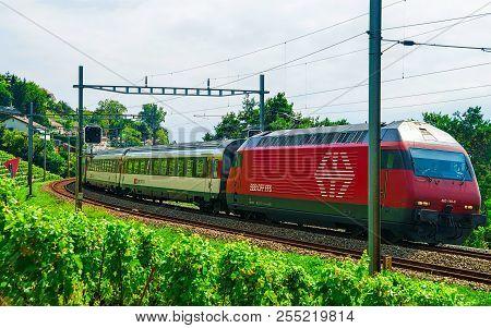 Lavaux, Switzerland - August 30, 2016: Running Train On The Railroad At Lavaux Vineyard Terraces Hik