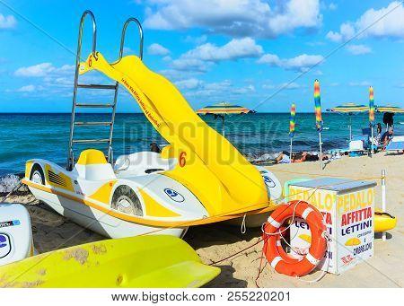 San Vito Lo Capo, Italy - September 17, 2017: Yellow Paddleboat At The Beach In San Vito Lo Capo, Si