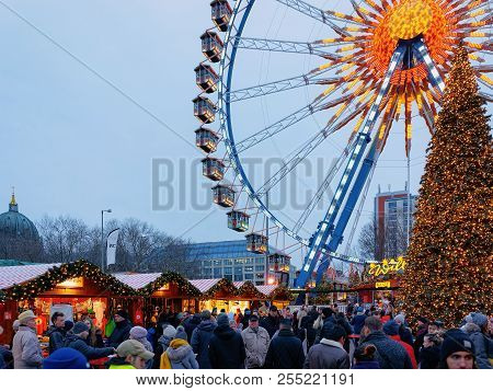 Berlin, Germany - December 10, 2017: Ferris Wheel And Christmas Tree At Christmas Market At Town Hal