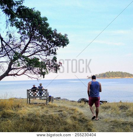 Man On An Island By The Shore Thinking And Contemplating