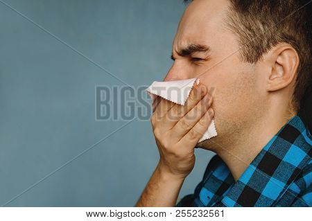 Allergic Reaction. The Guy Blows His Nose And Sneezing. The Guy Wipes His Nose With A Handkerchief A