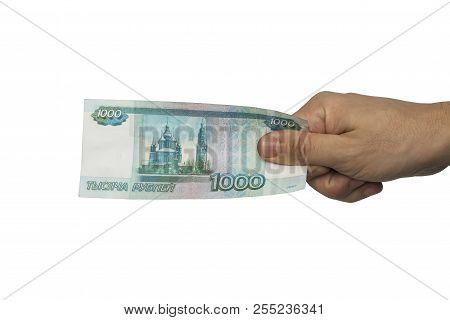 Hand With Russian Money Isolated On The White Background. One Thousand Roubles In Hand.