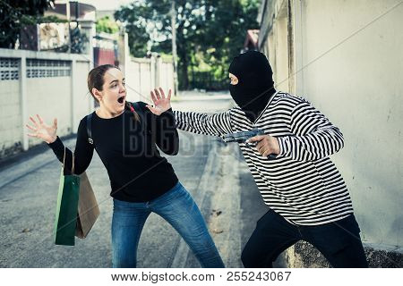 Robbery With A Firearm Secretly Hide Behind Walls.the Girl Shocked After Being Pulled Bag.concept Of