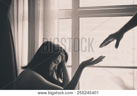 Husband Giving Hand To Depressed Wife,mental Health Care Concept,black And White Toned,selective Foc