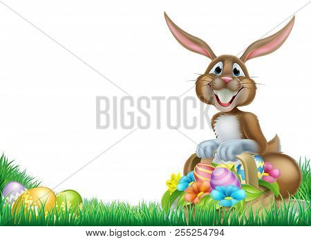 Easter Bunny With A Basket Full Of Decorated Chocolate Easter Eggs In A Field