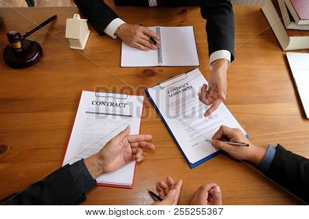 Businessman Consulting Lawyer & Signing Contract Agreement. Team Meeting At Law Firm. Estate Law & P