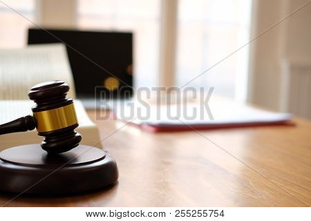 Legal Judge Gavel & Law Book At Courtroom. Lawyer Attorney Justice Workplace