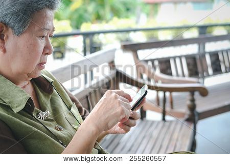 Elder Woman Holding Mobile Phone. Elderly Senior Female Texting Message, Using App With Smartphone O