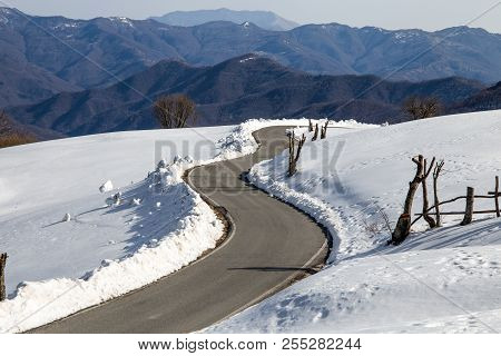 Winter Landscape In The Coutryside, Italy. Isolated Road In The Snow.