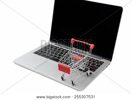 Shopping Cart On A Laptop Keyboard. Ideas About E-commerce, E-commerce Or Electronic Commerce Is A T