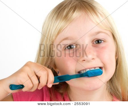 Girl Brushing Her Teeth