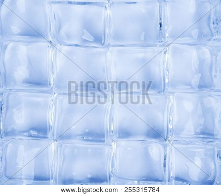 A Group Of Crystals On A Blue Background