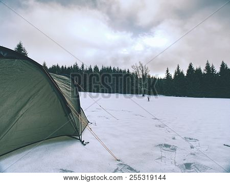 Winter Camp By The Lake In Winter At Dusk. Winter Adventure With Oversleeping In Wild Nature.