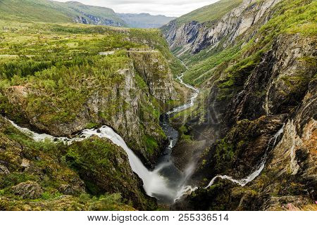Beautiful View Of The Voringsfossen Waterfall. Picturesque Mountain Landscape With Waterfalls.