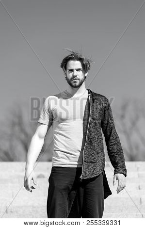 Man With Beard Wear Tshirt On Sunny Outdoor, Fashion. Macho Stand On Blue Sky, Perspective. Mens Fas